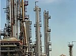Natural gas is produced at oil refineries like this one.  Photo by David Parsons.